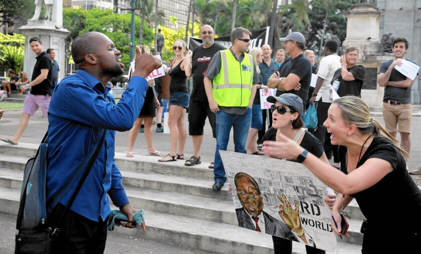Supporters and detractors argue over President Jacob Zuma in Durban, South Africa, in February.