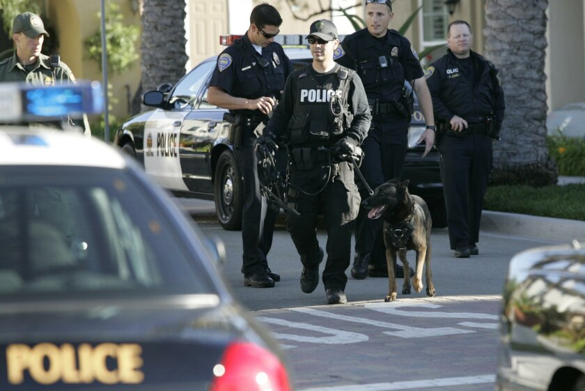 Chula Vista police and U.S. Border Patrol agents deployed five search teams in a housing development across from the Otay Ranch Town Center after three people got into a shootout before 7 a.m. Monday at the mall following a break-in at the Apple Store. A security guard exchanged gunfire with the th