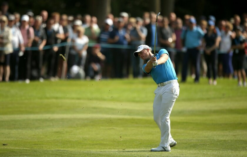 England's Masters champion Danny Willett in action on the sixteenth hole during day three of the PGA Championship at Wentworth Club, Virginia Water, England, Saturday May 28, 2016. Willett made six birdies in a tournament-record 29 on the front nine on Friday. (Steve Paston / PA via AP) UNITED KING