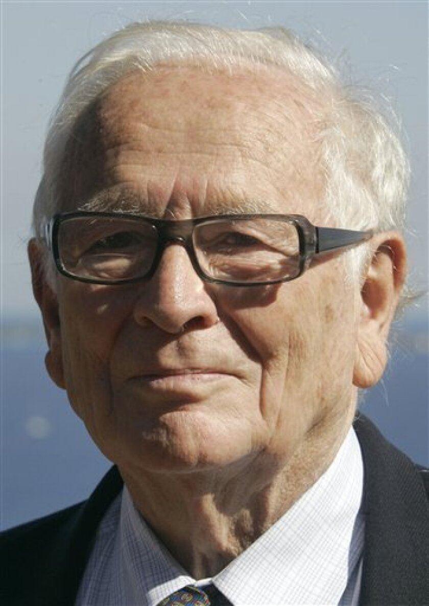 FILE - In this Oct.6, 2008 file photo, French fashion designer Pierre Cardin at his villa in Theoule sur Mer, southern France. A spokesman for the Cardin fashion house says the designer was taken by helicopter to a hospital in Marseilles Tuesday May 5, 2009 after fainting and falling . (AP Photo/Lionel Cironneau, File)