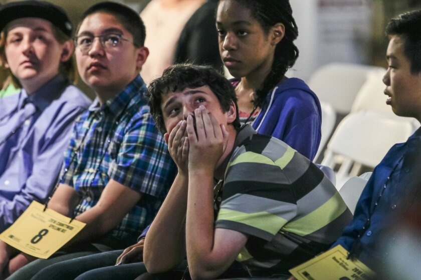 Bennett Hochner (2nd from right) reacts and watches.