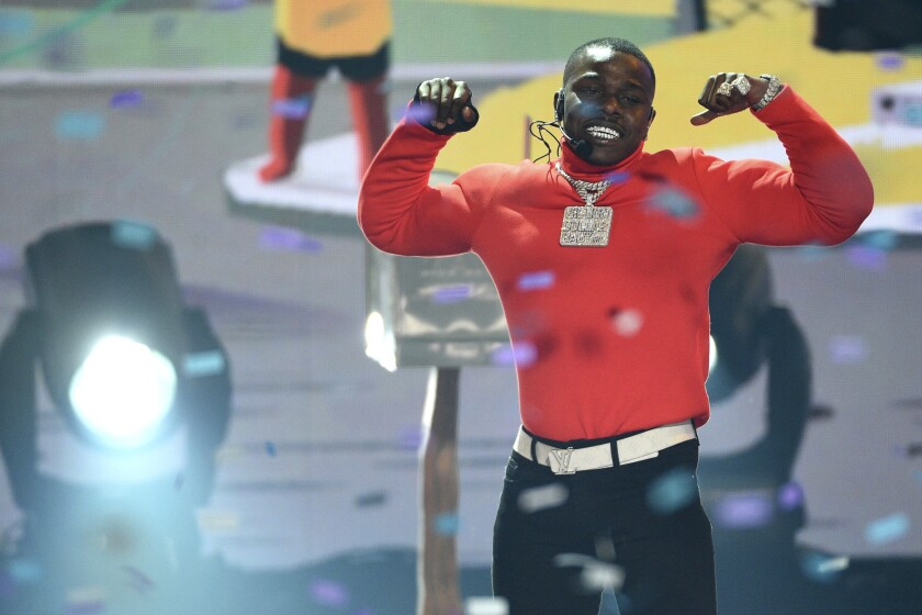 """FILE-In this June 23, 2019 file photo, DaBaby performs """"Sugar"""" at the BET Awards, at the Microsoft Theater in Los Angeles. The Grammy-nominated rapper was arrested on a battery charge in Miami on Thursday night Jan. 2, 2020, and is being held on an arrest warrant out of Texas, according to court records. (Photo by Chris Pizzello/Invision/AP, File)"""