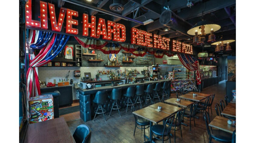 Motorcycle daredevil Evel Knievel inspired the new Evel Pie pizzeria. His son Kelly is a partner in the new restaurant.