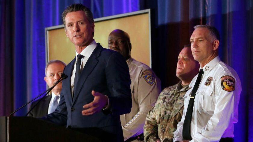 Gov. Gavin Newsom speaks at the California for All: Emergency Management Preparedness Summit on June 3 in Sacramento.