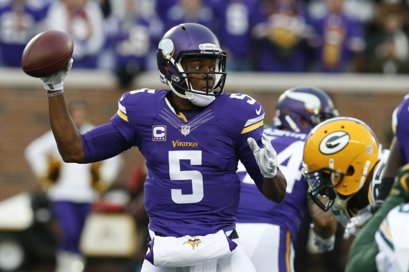 Minnesota Vikings quarterback Teddy Bridgewater (5) prepares to throw against the Green Bay Packers during the first half of an NFL football game in Minneapolis, Sunday, Nov. 22, 2015. (AP Photo/Jim Mone)