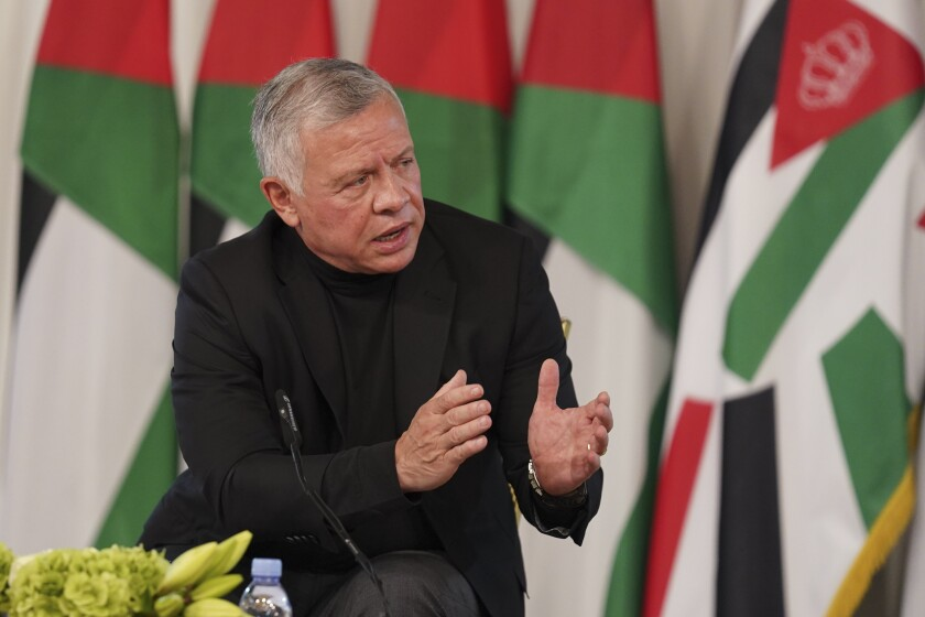 Jordan's King Abdullah II speaks during a meeting with tribal leader in Al-Qasta, south of Amman, Jordan, Monday, Oct. 4, 2021. King Abdullah II denied Monday any impropriety in his purchase of luxury homes abroad, an effort to contain a budding scandal over reports of lavish spending at a time when he has sought international aid to pull his impoverished country out of recession and help it cope with soaring unemployment. (Yousef Allan/The Royal Hashemite Court via AP)