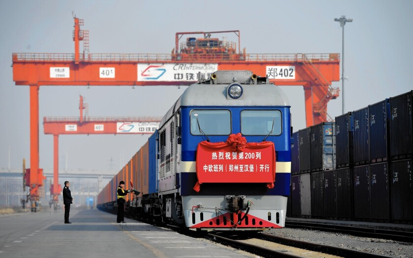 "A cargo train bound for Germany waits in Zhengzhou, China. China's leadership envisions a ""New Silk Road"" of global economic expansion with such train routes."