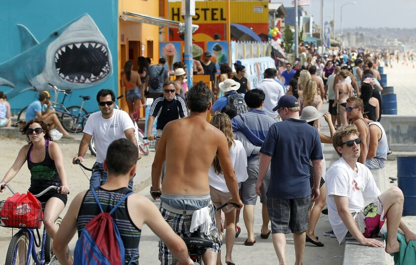 The Pacific Beach boardwalk was crowded with pedestrians, bicyclists and skateboarders seeking some time on the beach on Memorial Day.