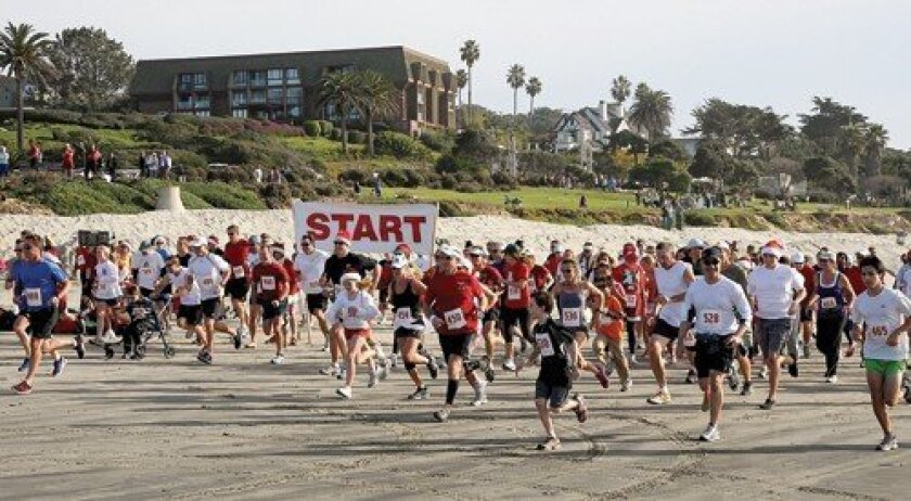 And they're off at the 20th annual Red Nose Run. Photo: Jon Clark