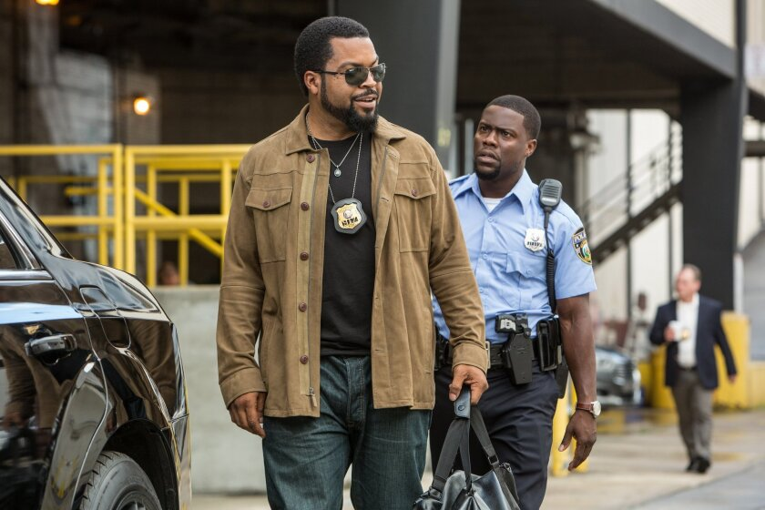 """Ice Cube, left, stars as James Payton and Kevin Hart as Ben Barber in a scene from """"Ride Along 2,"""" the sequel to Universal Pictures' 2014 surprise buddy cop comedy."""