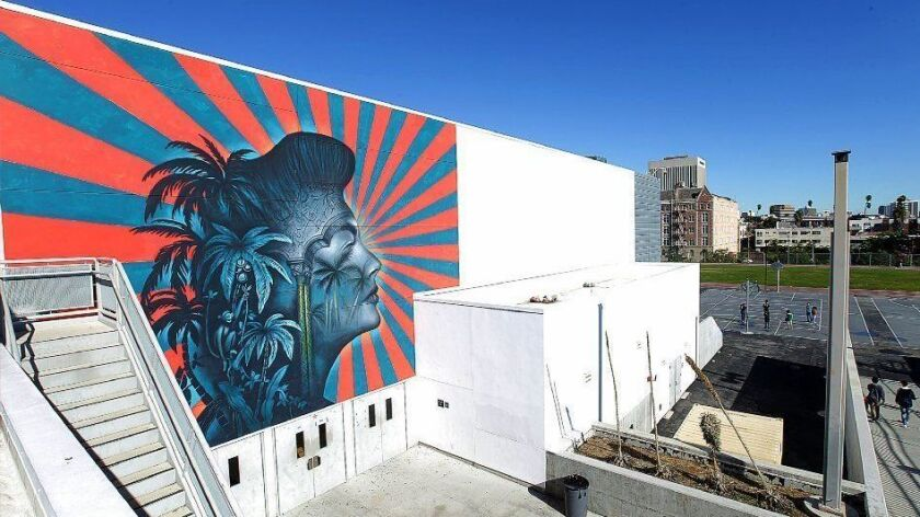 The Los Angeles Unified School District has agreed to remove a mural in Koreatown that some say evokes the imperial Japanese battle flag.