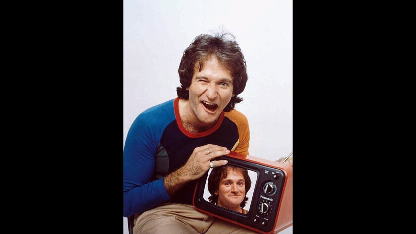 A portrait of Robin Williams at age 27 was installed at the National Portrait Gallery on Tuesday.