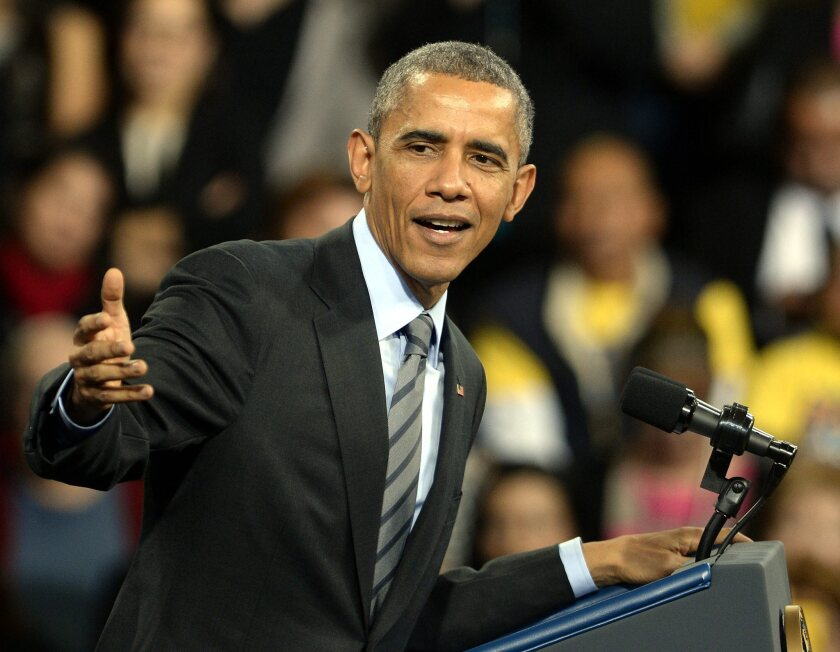 President Obama points to members of Congress during a speech on his immigration policy in which he urged Congress to bring the bill up for a vote at Del Sol High School in Las Vegas, Nev.