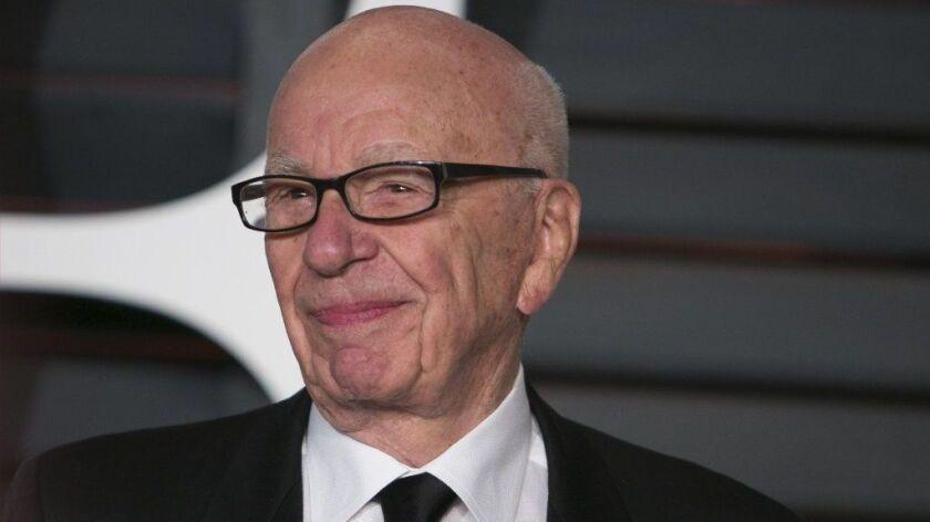 Rupert Murdoch arrives at the Vanity Fair Oscar party in Beverly Hills on Feb. 22, 2015.