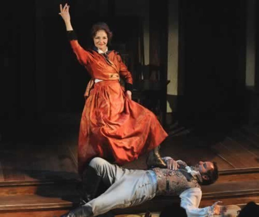 The Lady (Jacquelyn Ritz) easily handles the Nobel Lord (Randall Dodge)  in the musical comedy 'Man with a Load of Mischief' by Ben Tarver at North Coast Repertory Theatre.