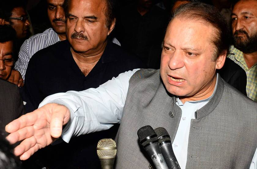 Nawaz Sharif speaks to journalists after visiting campaign rival Imran Khan in a hospital in Lahore, Pakistan. Sharif, the presumptive new prime minister, pledged to work with Khan for the good of the country.