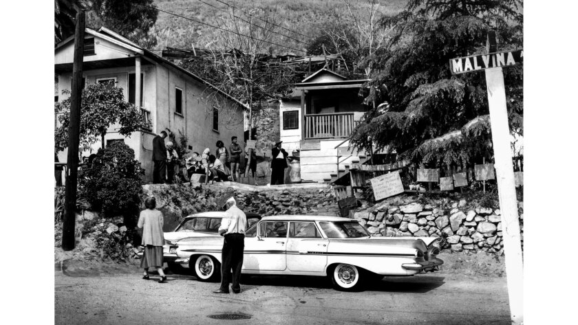April 14, 1959: Several weeks before the eviction, residents of Malvina Avenue gather while waiting