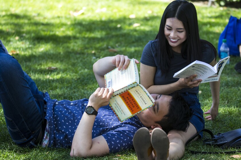 Jason Ham, 23, of Los Angeles rests his head on Baily Pham's legs during the Times Festival of Books.