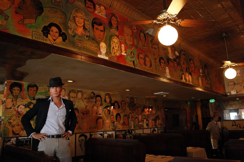 Palm co-owner Bruce Bozzi Jr., is surrounded by caricatures of celebrities that grace the walls the West Hollywood restaurant. After 40 years, Palm is moving to Beverly Hills, but most of the sketches won't be making the trip.