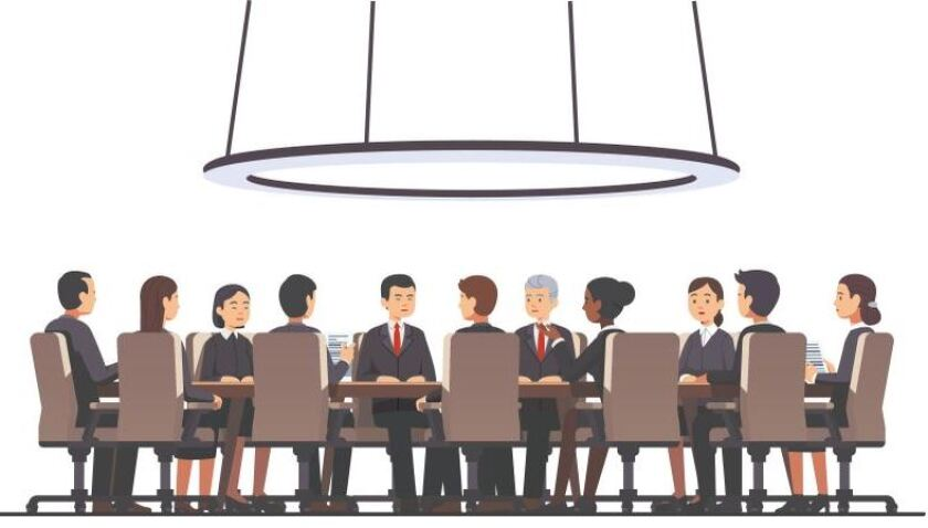 Men and women sit around a conference table.