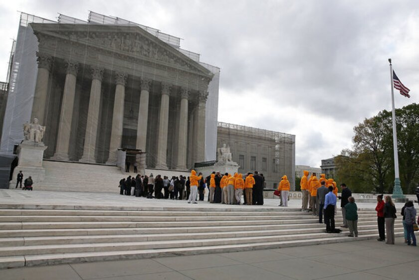By an 8-1 vote, Supreme Court justices on Monday let stand lower court rulings that said enforcing the immigration laws is the job of the federal government, not the states.