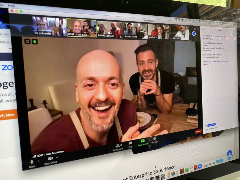 Two men appear in a video, on a computer screen