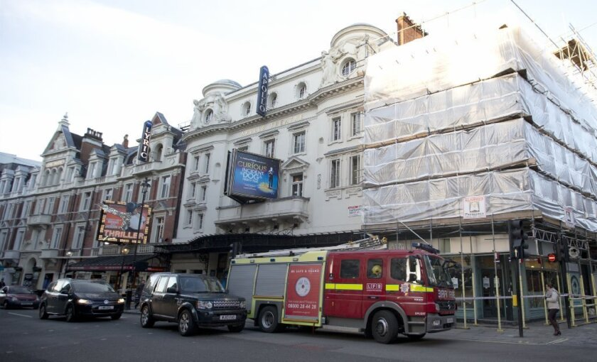 """A fire brigade truck waits outside the Apollo Theatre in London on Friday following a partial structural collapse during a Thursday evening performance of the play """"The Curious Incident of the Dog in the Night-Time."""""""