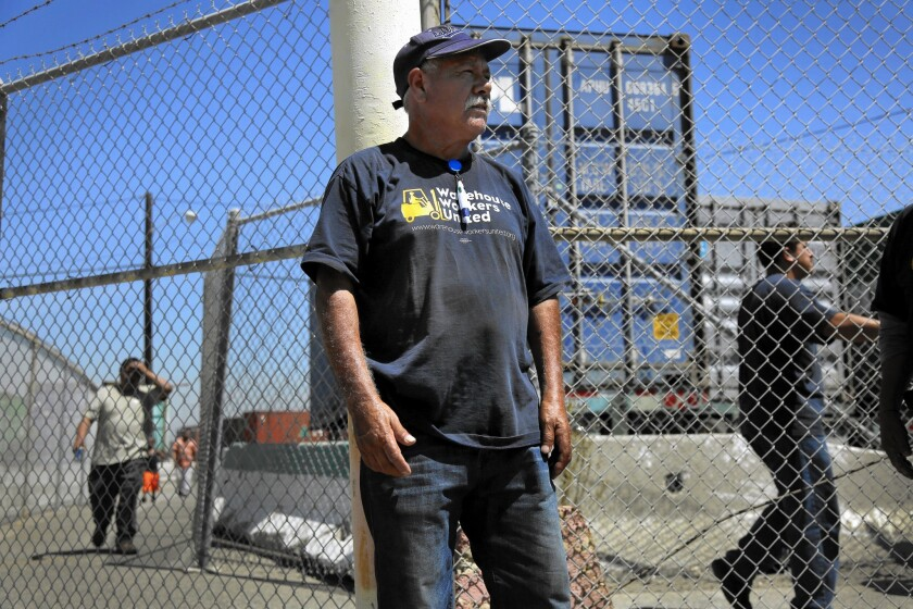 Alberto Arenas works at the Port of Los Angeles, where a group of warehouse workers has filed a class-action lawsuit seeking better wages.