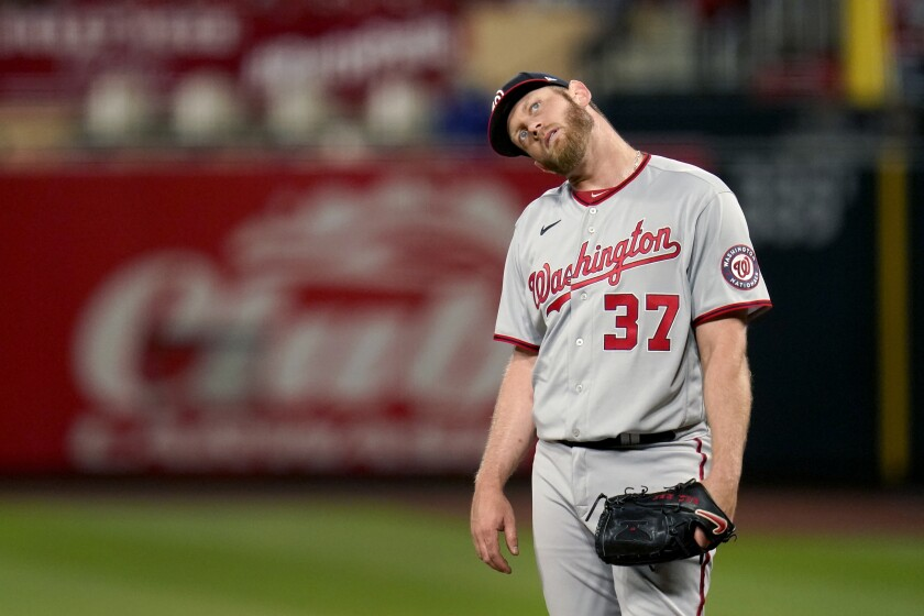 Washington Nationals starting pitcher Stephen Strasburg stands on the mound after giving up a two-run home run to St. Louis Cardinals' Matt Carpenter during the third inning of a baseball game Tuesday, April 13, 2021, in St. Louis. (AP Photo/Jeff Roberson)