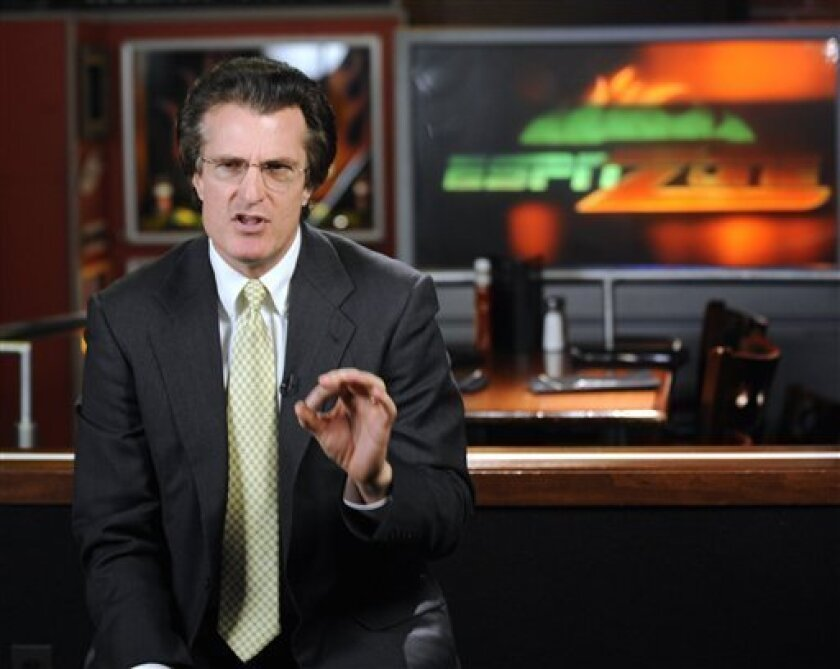 In this Tuesday, April 7, 2009 photo, football draft analyst Mel Kiper Jr. talks about the draft during a taping at the ESPN Zone in Baltimore. Saturday marks the 25th anniversary of Kiper's 1984 debut on ESPN's draft coverage, and while his demeanor and hair haven't changed all that much, his popularity certainly has. (AP Photo/Gail Burton)