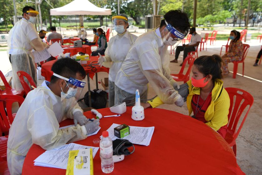 Medical workers in face shields