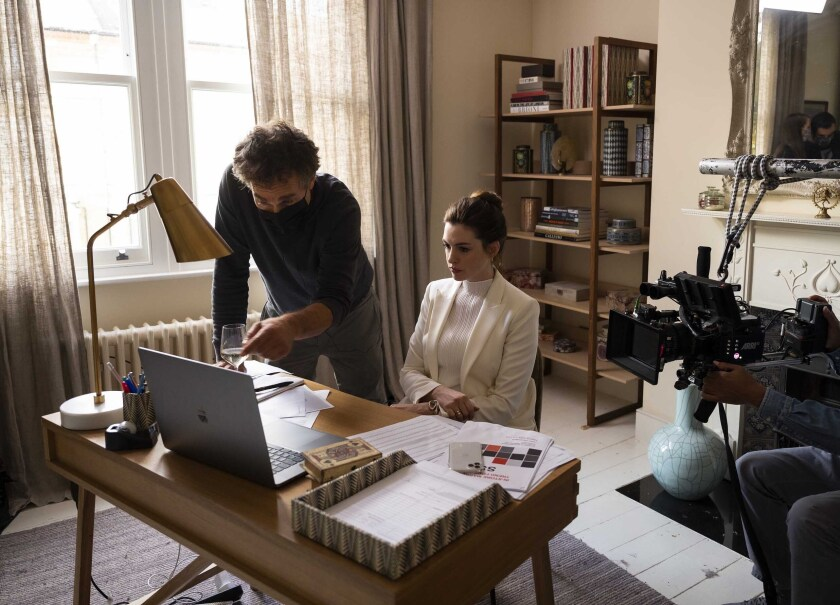 "This image released by HBO Max shows director Doug Liman, left, with actress Anne Hathaway on the set of ""Locked Down."" In four months, in the middle of a pandemic and widespread shutdowns, Liman and his team wrote, shot and edited a glossy Harrods heist film in London with Hathaway and Chiwetel Ejiofor. The result, ""Locked Down,"" comes to HBO Max Thursday. (Susie Allnutt/HBO Max via AP)"