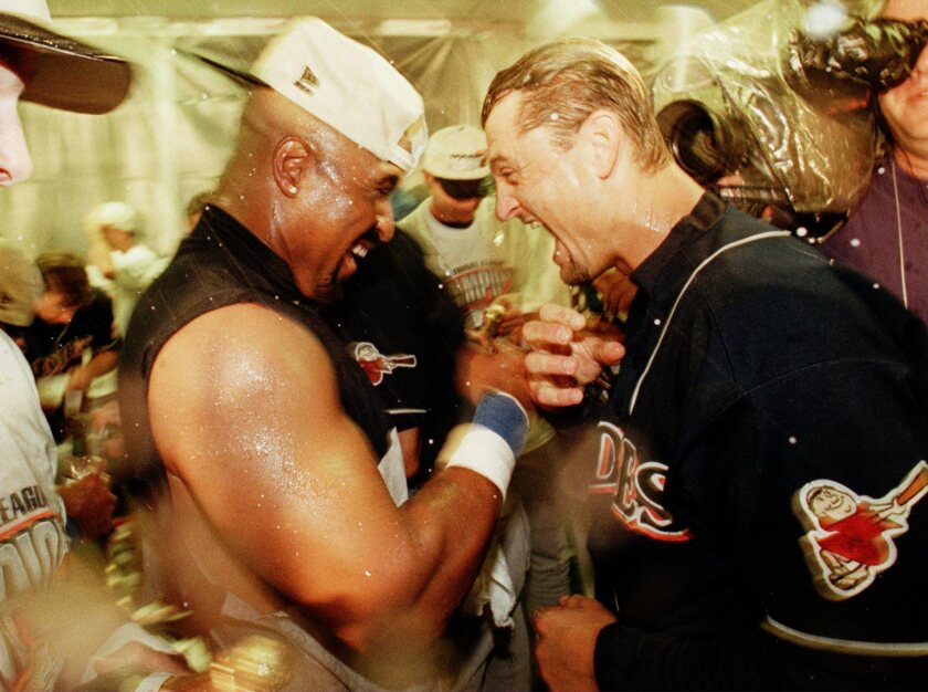 Greg Vaughn and Trevor Hoffman celebrate in way that would be discouraged if Padres made the postseason in shortened season.
