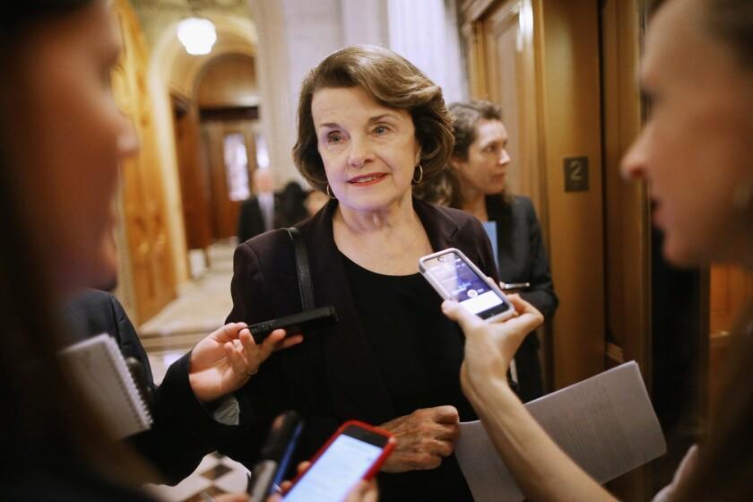 Sen. Dianne Feinstein (D-Calif.) leaves the Senate floor in January.