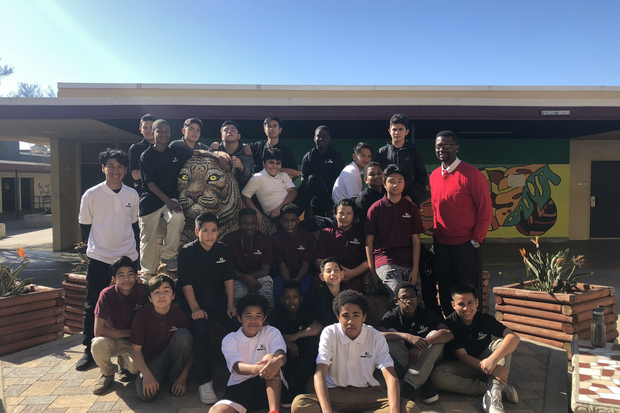 Roosevelt Johnson, top right, stands with students in Wilson Middle School's Man Up program.