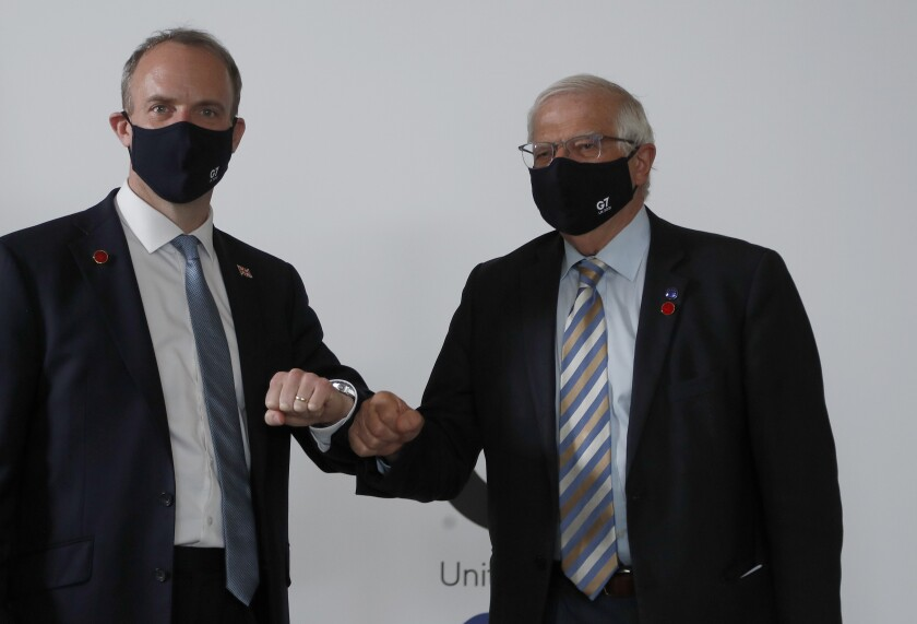 High Representative of the EU for Foreign Affairs Josep Borrell, right, and Dominic Raab Secretary of State for Foreign Affairs meet ahead of bi-lateral talks during the G7 foreign ministers' meeting in London, Wednesday, May 5, 2021. Foreign ministers from the Group of Seven wealthy industrialized nations gather in London to grapple with threats to health, prosperity and democracy. It is their first face-to-face meeting in more than two years. (AP Photo/Frank Augstein, pool)