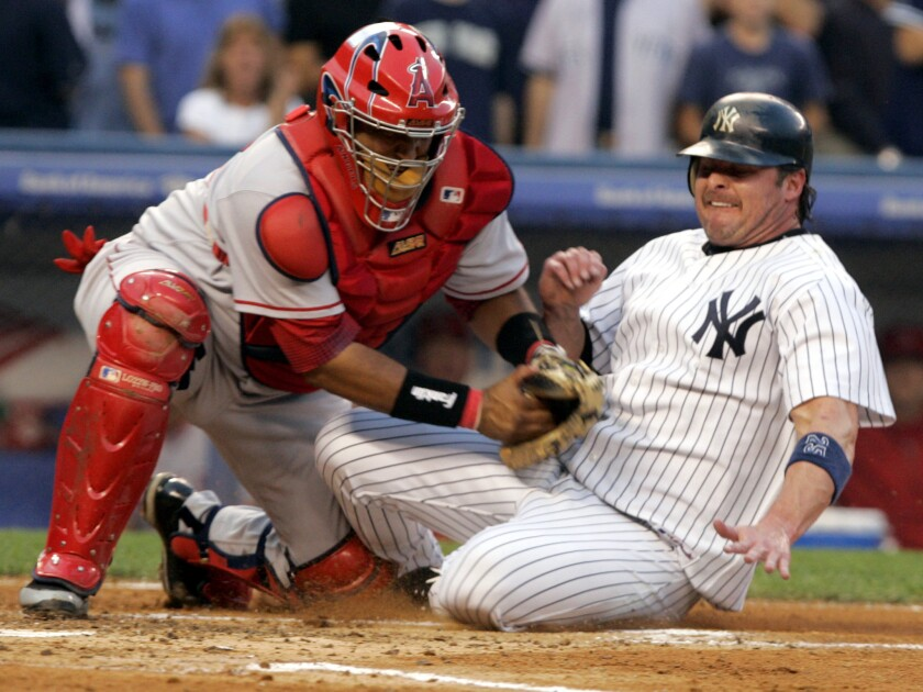 Angels catcher Jose Molina, left, tags out the Yankees' Jason Giambi during a game at Yankee Stadium in August 2006.