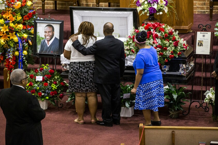 Mourners at a public viewing for Botham Jean, who was shot and killed in his Dallas home by an off-duty police officer who said she thought Jean was an intruder.