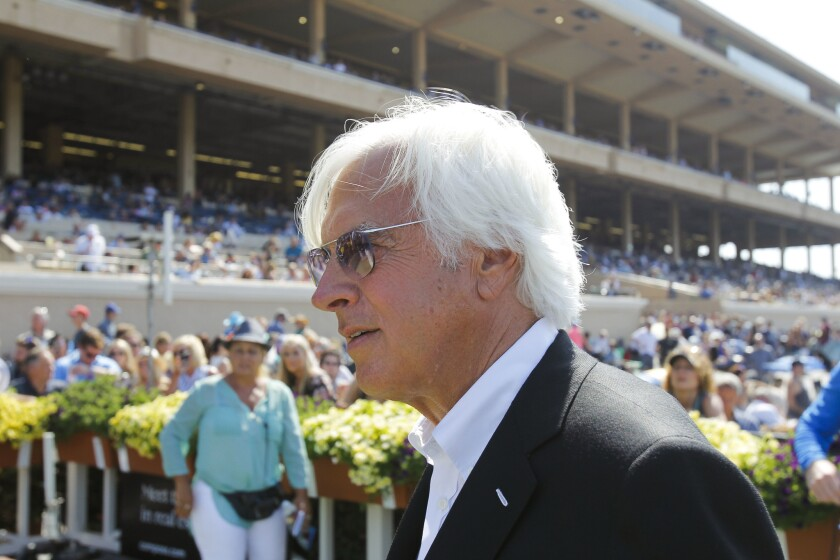 DEL MAR, July 28, 2018 | Horse trainer Bob Baffert stands in the winners circle after Triple Crown w