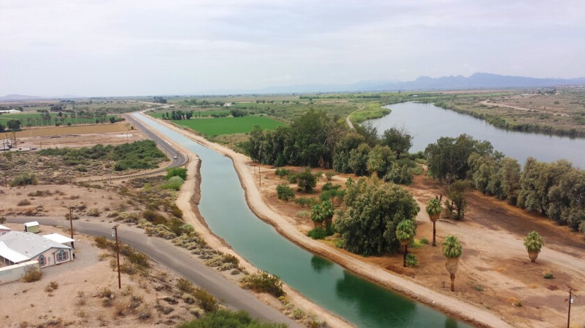 In this undated photo provided by Angie Ingram/CRIT Water Resources, a canal system on the Colorado River Indian Tribes (CRIT) reservation is seen near Parker, Ariz. The tribe has played an outsized role in Arizona to help keep Lake Mead from falling to drastically low levels. Still, Arizona is expected to face the first-ever mandatory cuts to its Colorado River water supply in 2022. (Angie Ingram/CRIT Water Resources via AP)