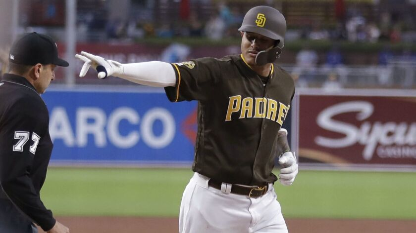 San Diego Padres' Manny Machado gestures as he rounds the bases after hitting a two-run home run dur