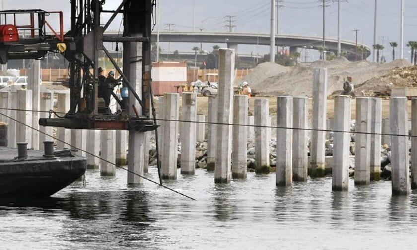 Concrete piles are pounded into place in May for a new cargo ship pier at the Port of Los Angeles as the L.A. and Long Beach ports embark on their most ambitious expansion and renovation projects to date.