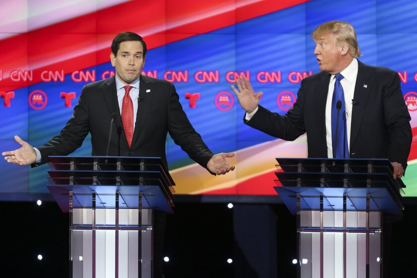 Republican presidential candidates, Sen. Marco Rubio, R-Fla, left, and businessman Donald Trump argue while answering a question during the Republican Presidential Primary Debate at the University of Houston Thursday, Feb. 25, 2016. (AP Photo/Houston Chronicle, Gary Coronado, Pool) MANDATORY CREDIT