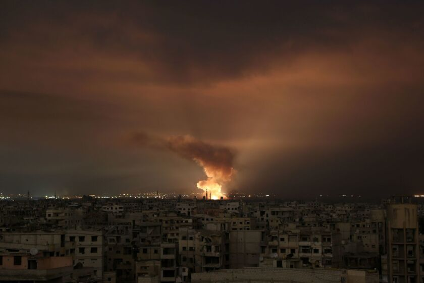 A Syrian regime airstrike on the besieged Eastern Ghouta area, which sits on the outskirts of the capital Damascus, late on Feb. 23, 2018.