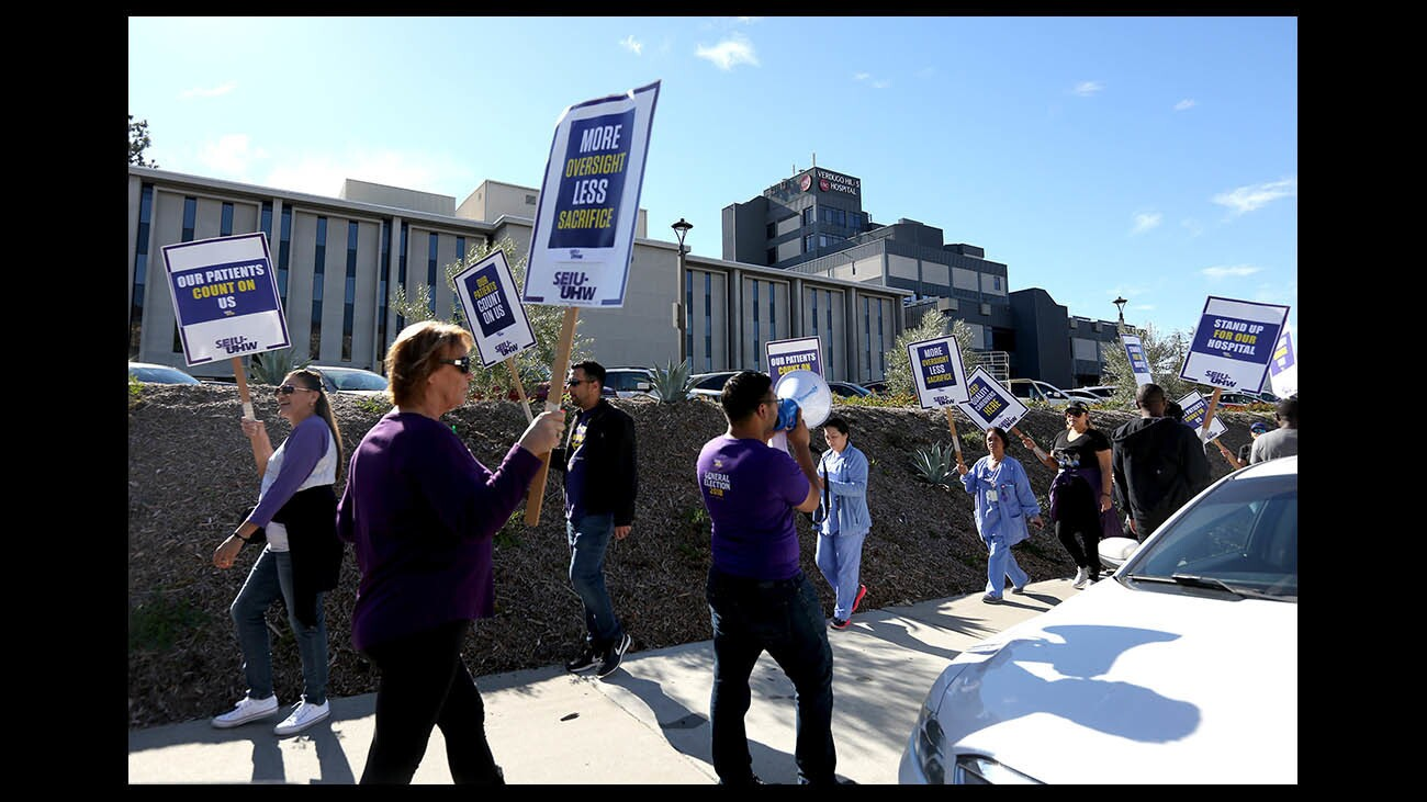 Photo Gallery: Union pickets outside Verdugo Hills Hospital while one person inside meets to decertify the union