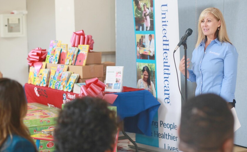 United Healthcare representative Monique Knight reads Sesame Street books to preschool children at St. Johns Head Start in Chula Vista in April. UnitedHealthcare donated 8,000 beginning reader books and 24 Sesame Street stations to nonprofit organizations throughout San Diego as part of a reading and healthy living program.