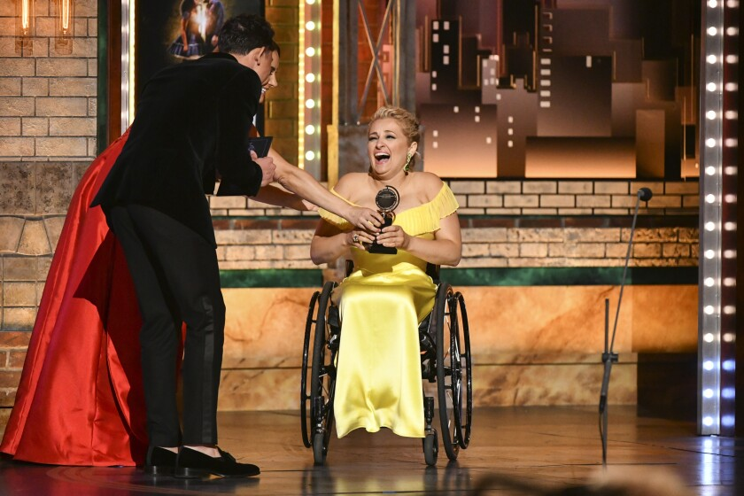 """FILE - Ali Stroker accepts the award for best performance by an actress in a featured role in a musical for her performance in """"Rodgers & Hammerstein's Oklahoma!"""" at the 73rd annual Tony Awards in New York on June 9, 2019. Stroker teamed up with middle grade author Stacy Davidowitz for a new children's book """"The Chance to Fly,"""" published this week. (Photo by Charles Sykes/Invision/AP, File)"""