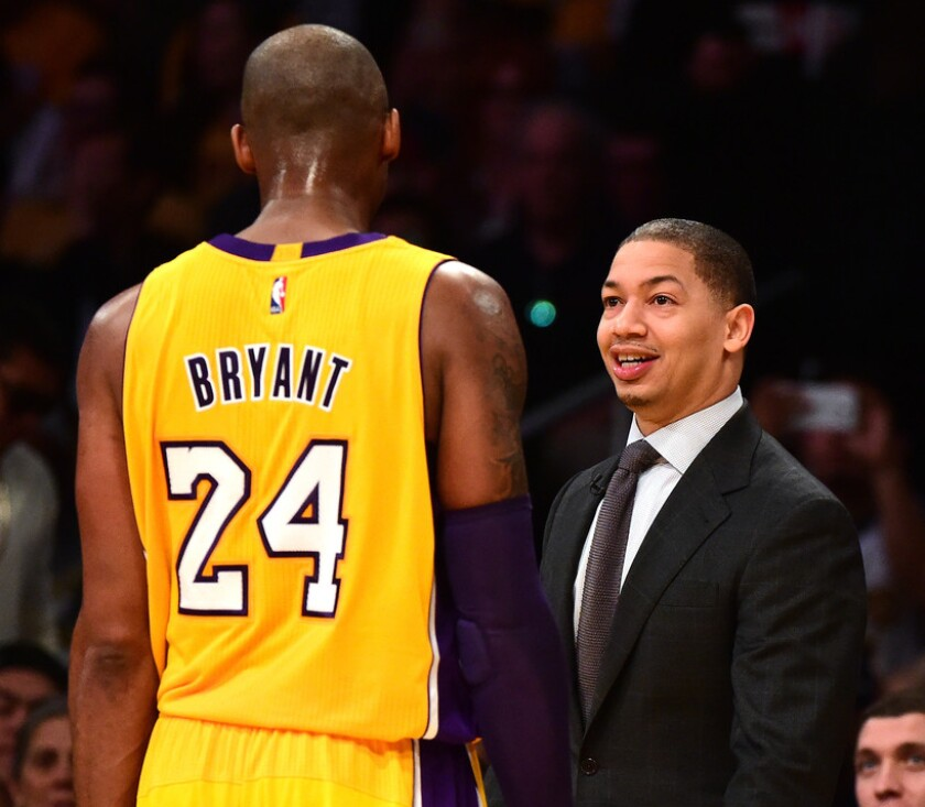 Lakers star Kobe Bryant and Cavaliers coach Tyronn Lue exchange greetings before a game in 2016.