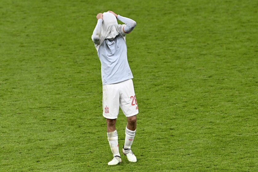 Spain's Pedri reacts at the end of the Euro 2020 soccer championship semifinal match between Italy and Spain at Wembley stadium in London, Tuesday, July 6, 2021. Italy defeated Spain 4-2 in a penalty shootout after the game ended tied 1-1 after extra time.(Facundo Arrizabalaga/Pool Photo via AP)
