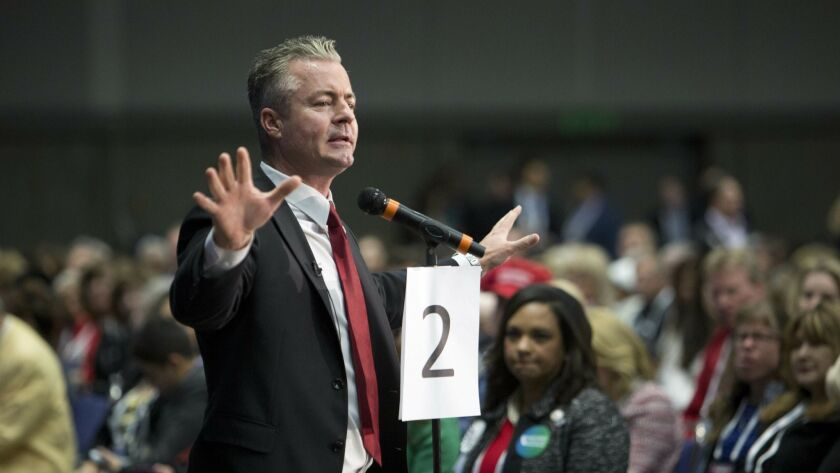 Travis Allen, candidate for chair of the California Republican Party, speaks to delegates after his